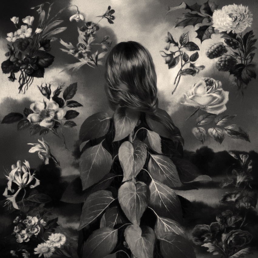 Black and white back of woman's head with leaves and flowers