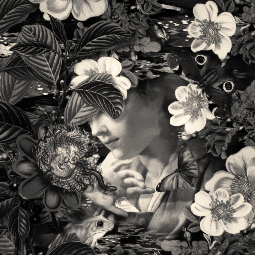 Black and white of woman with flowers, butterfly, and frog