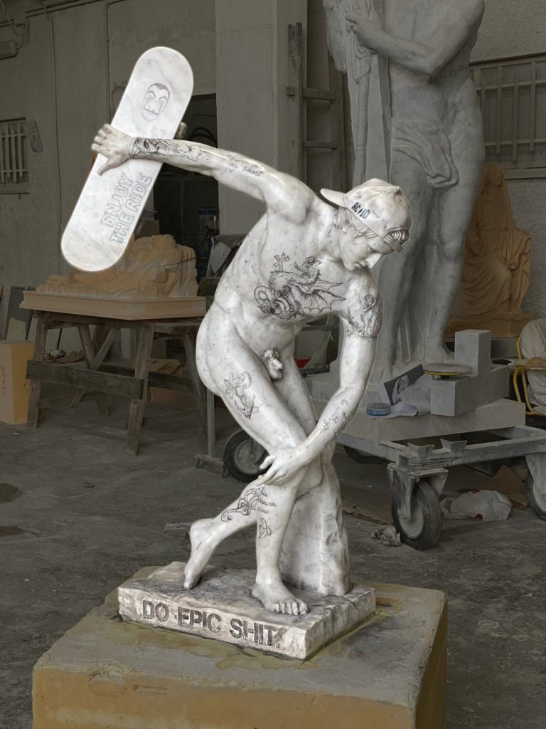 marble statue of skateboarder