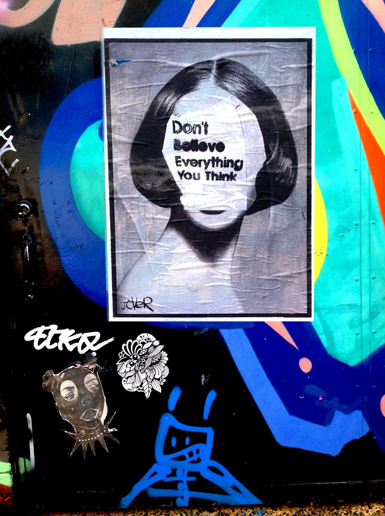 Don't believe everything you think paste up art in Melbourne, Australia by Loui Jover
