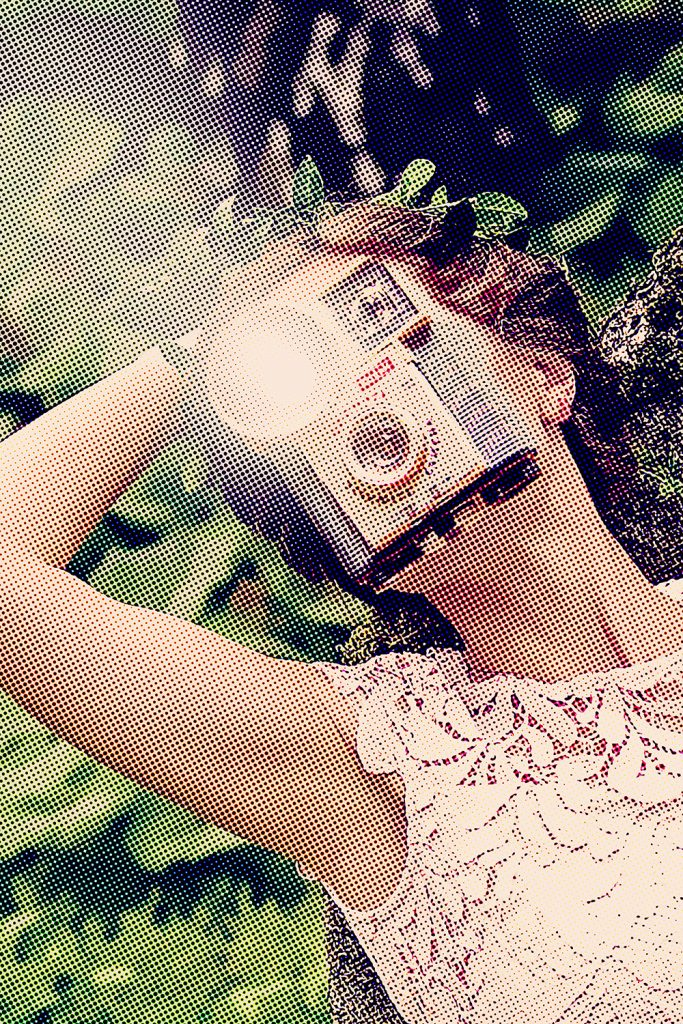 photograph of woman with camera face